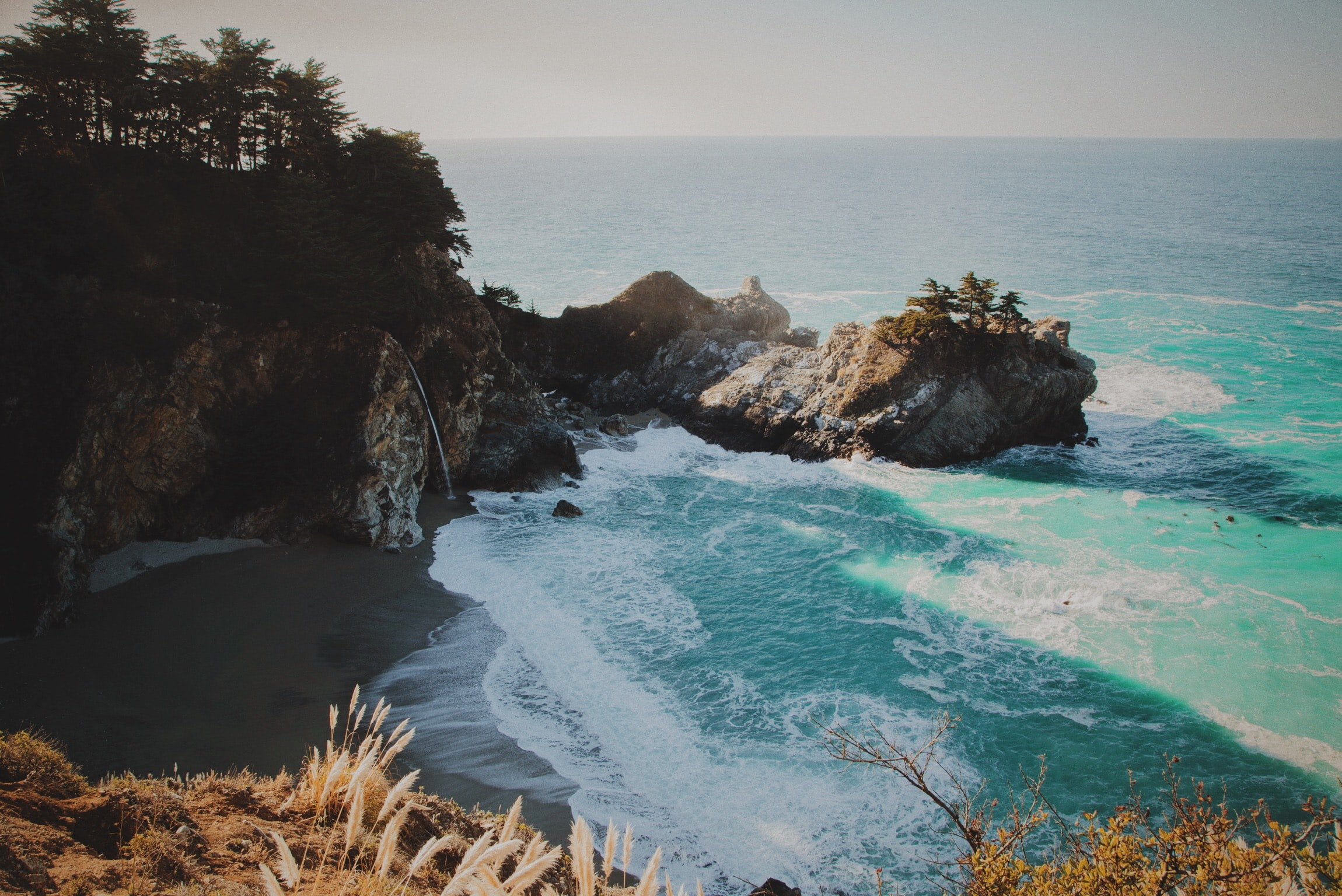 View of an ocean bay from a cliff at McWay Falls