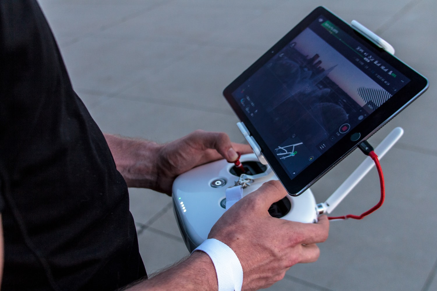 A person is holding a controller for the DIY Drone