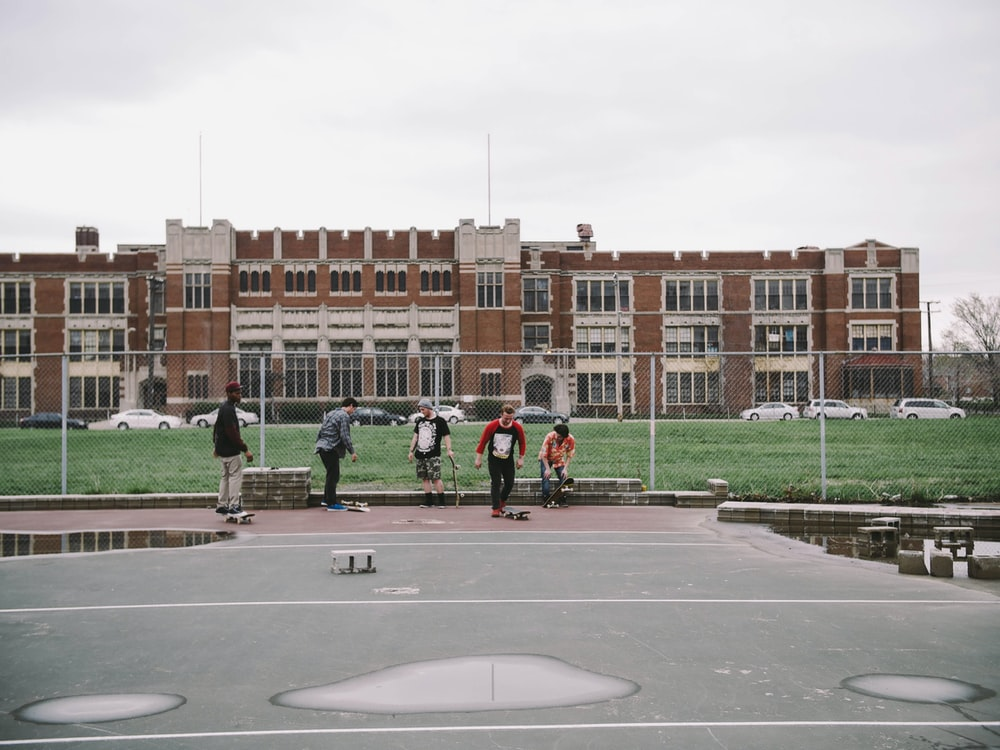 group of people near brown building