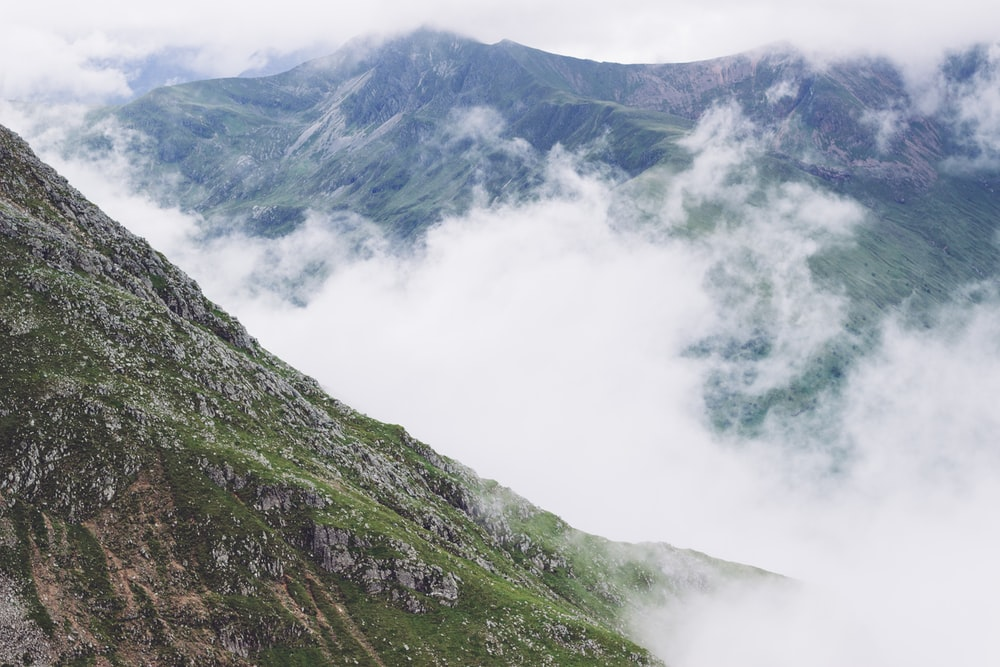aerial view photo gray of mountain covering by mist