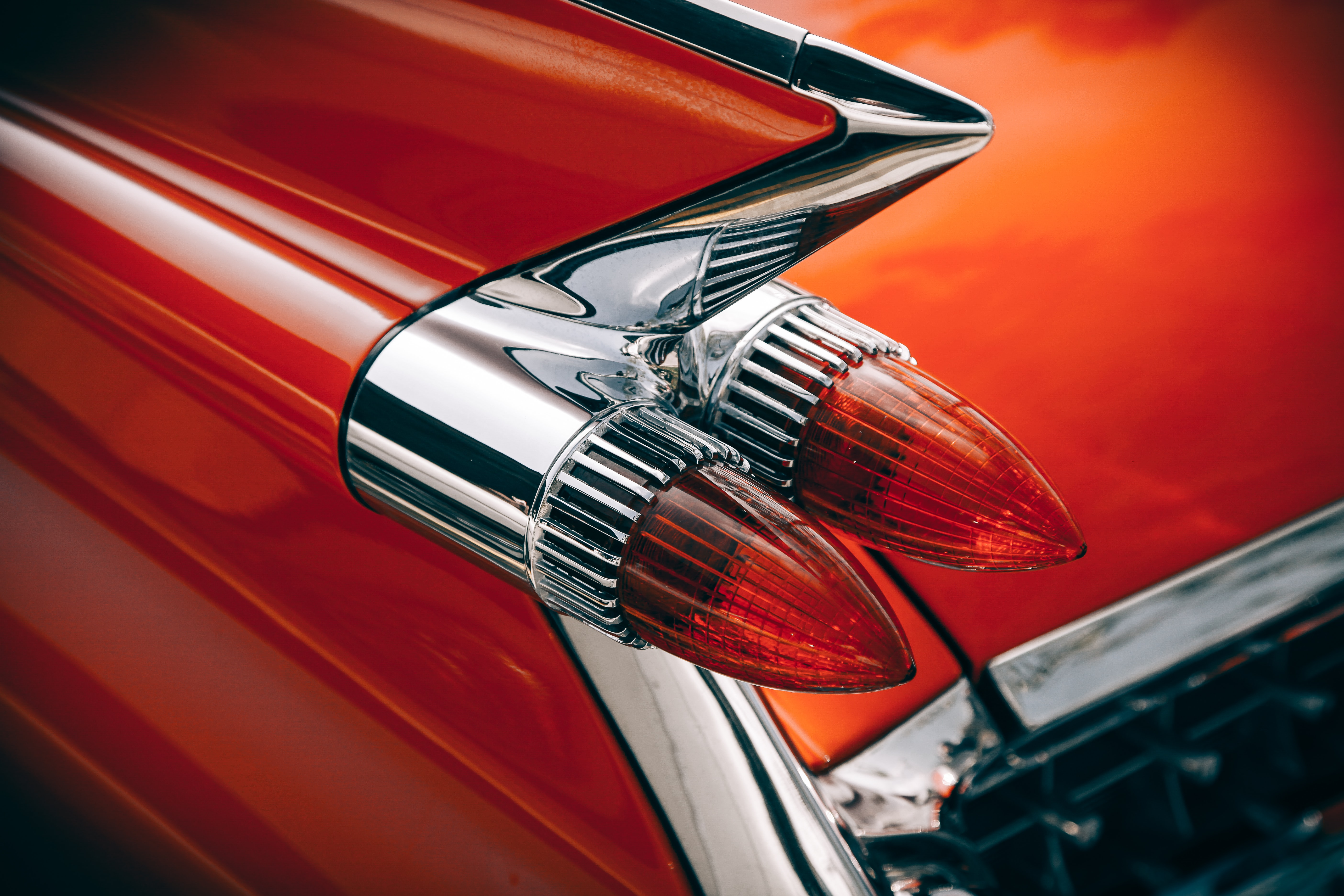 Macro shot of a red vintage car's tail light.
