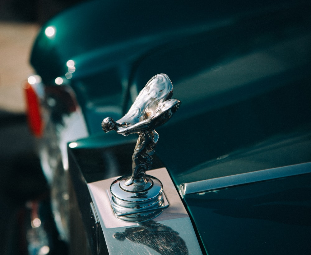 silver-colored vehicle ornament