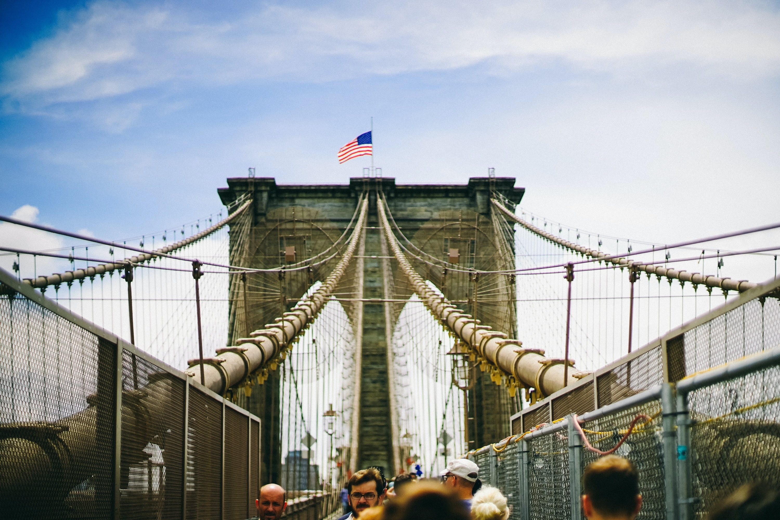 A pedestrian's view of a walkway on the Brooklyn Bridge