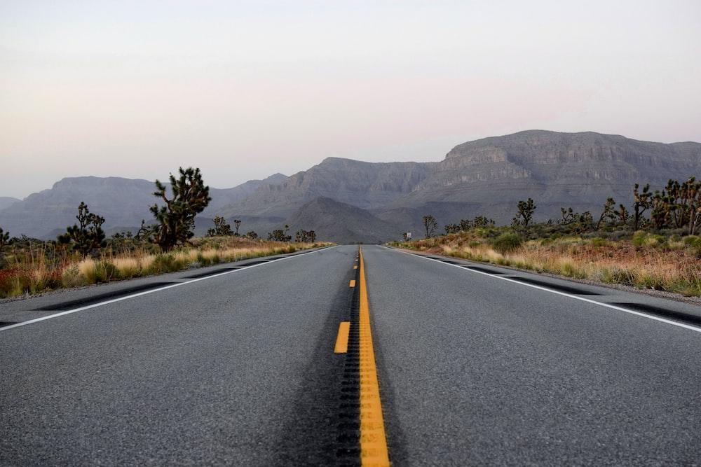 empty road towards mountains