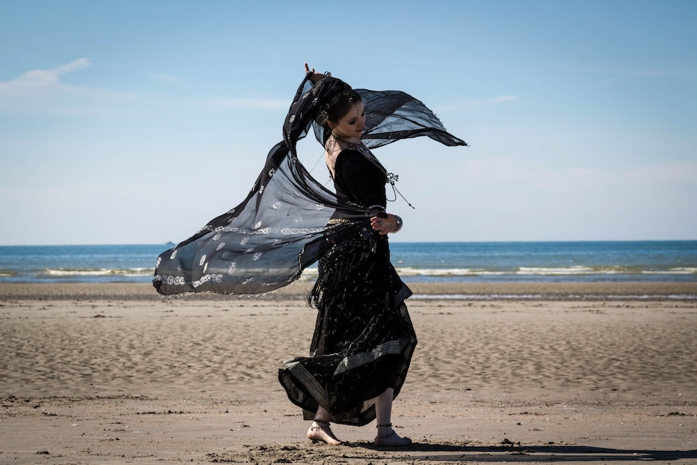 woman dancing on seashore
