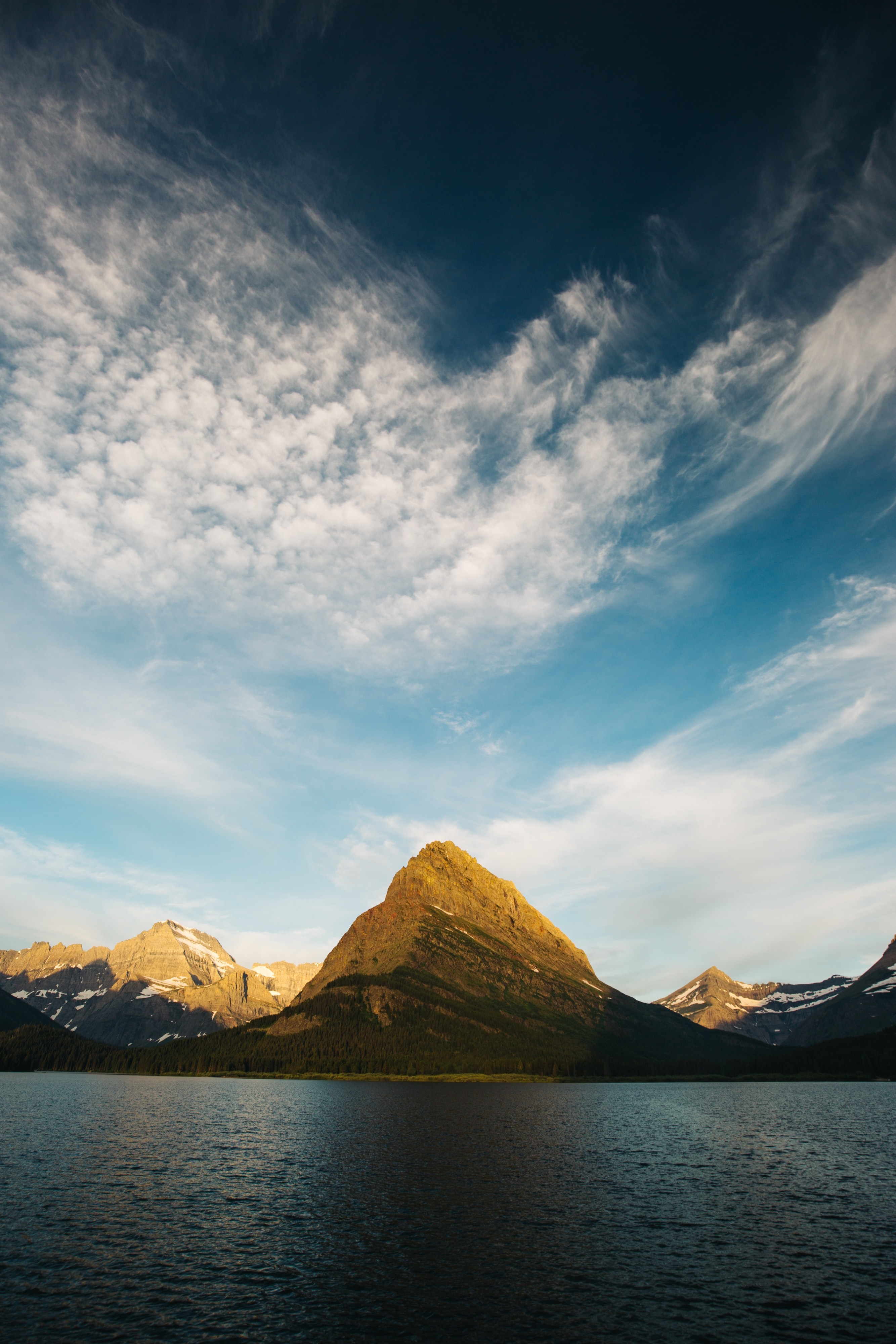 landscape photography of mountains beside body of water