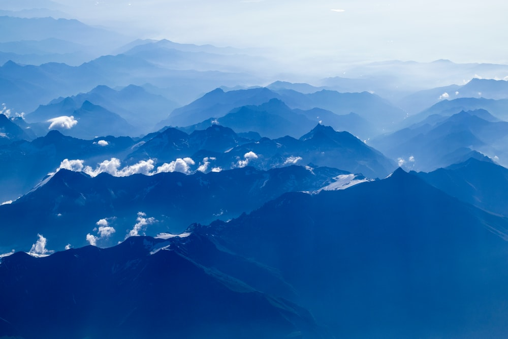 aerial photography of mountain under clear blue sky