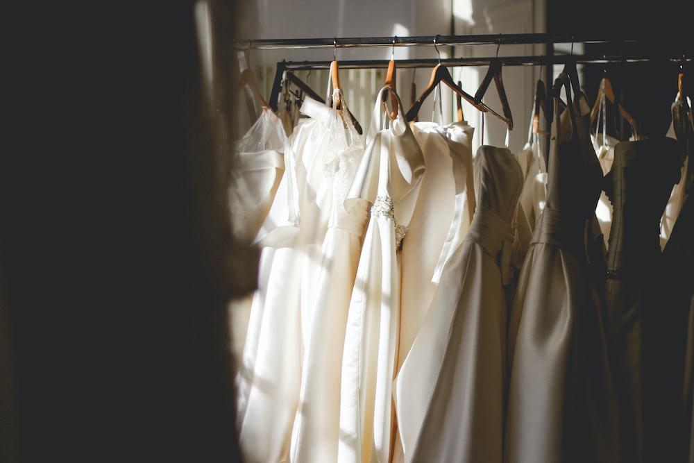 f854b4ada3b five women s white hanged gowns