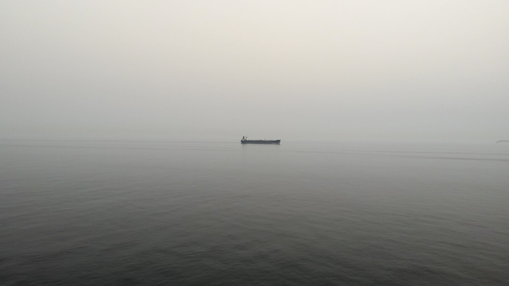 black boat on body of water