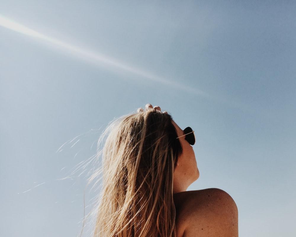 woman wearing gold framed Aviator sunglasses