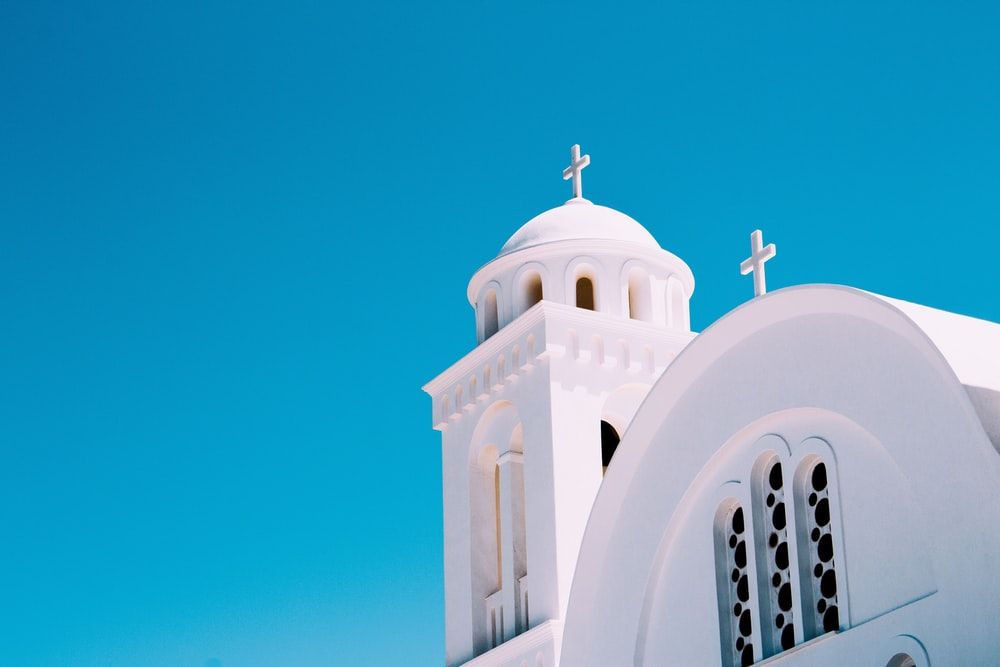 low-angle photography of white church