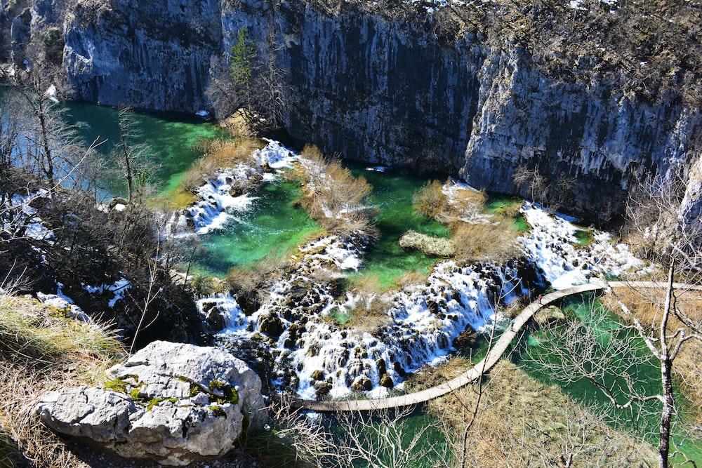 aerial photo of bridge near rock formation