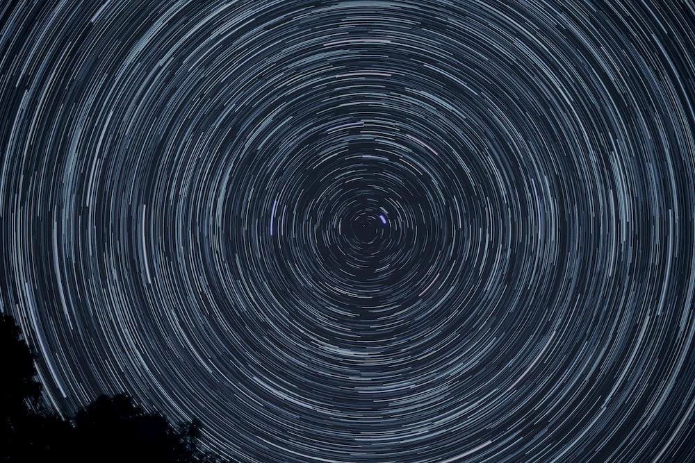 spiral gray and black digital wallpaper