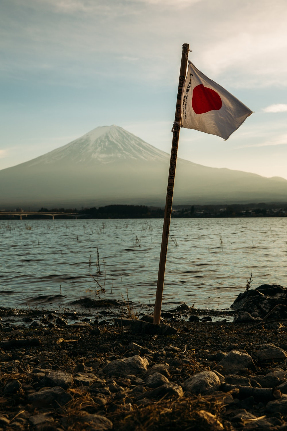 Japan flag mounted near on body of water
