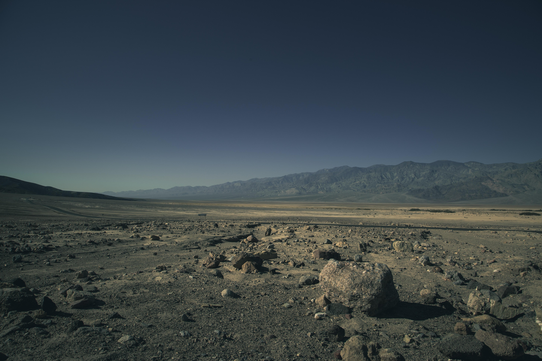 Dark skies over a desolate rocky desert