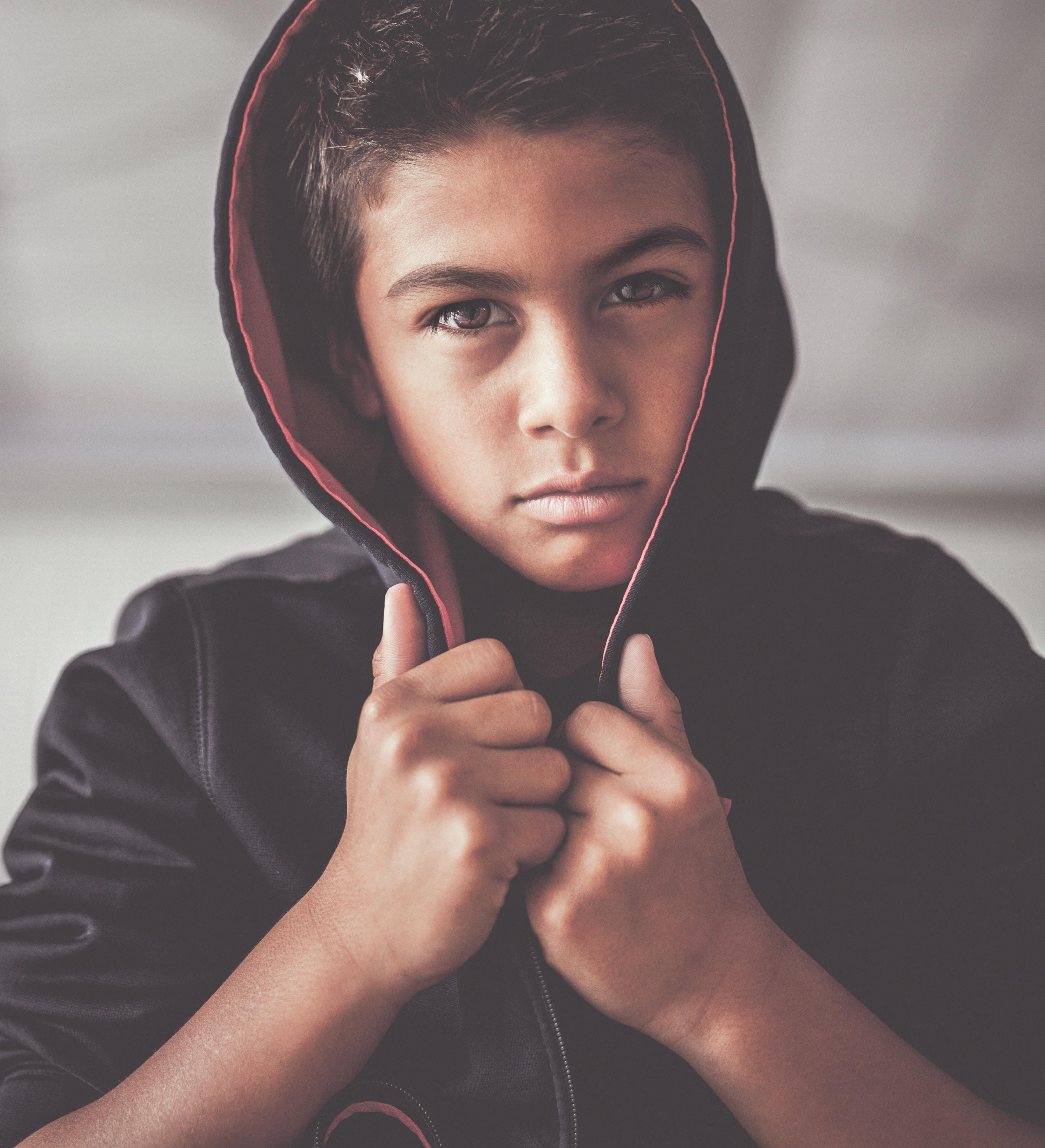 boy in black hoodie