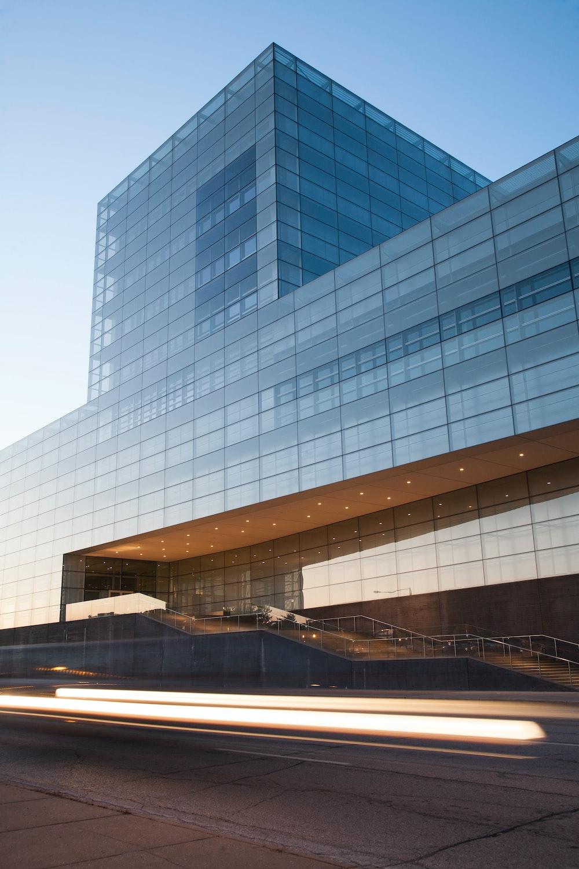Light trails near the glass facade of an office building