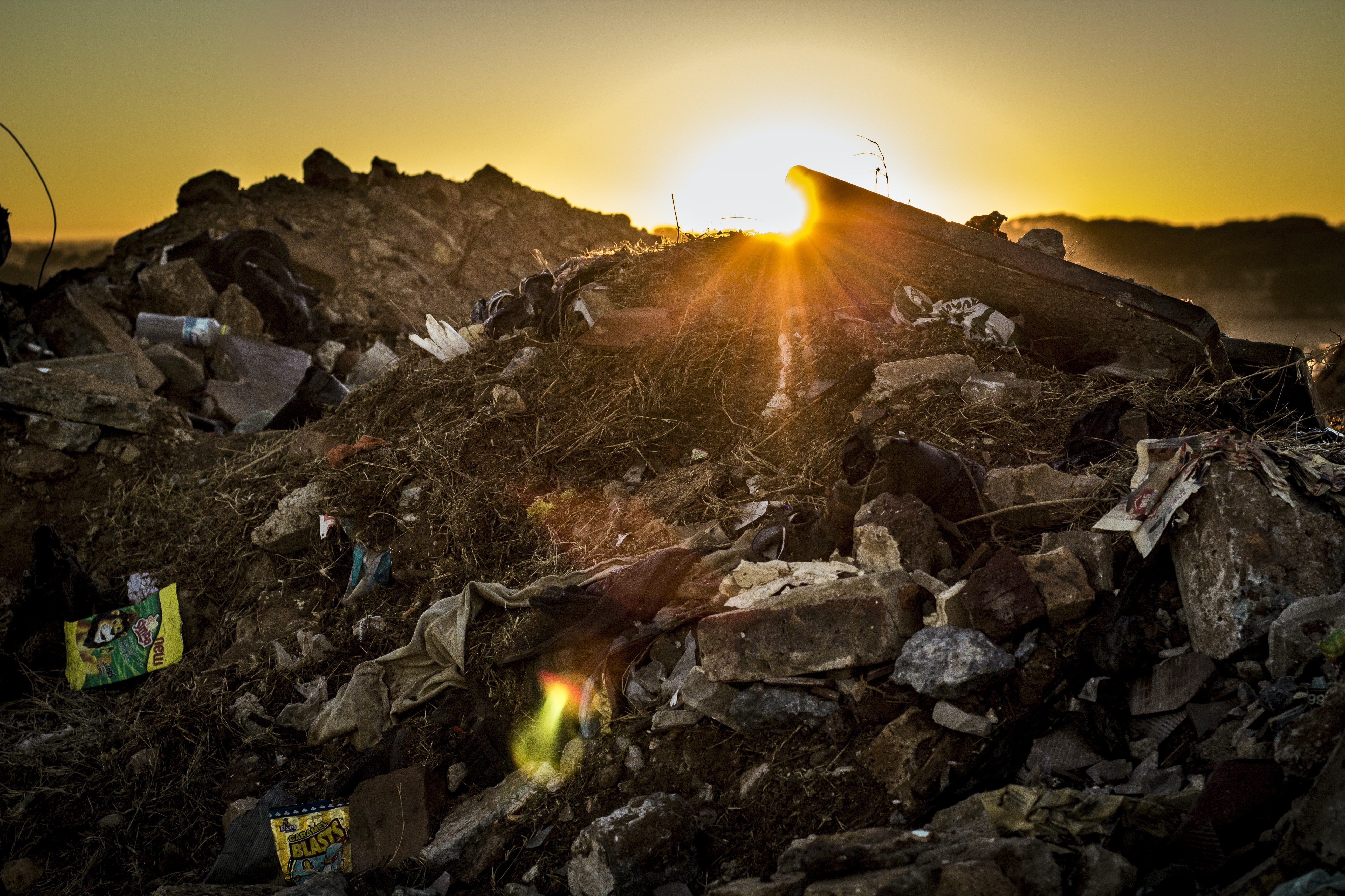 A picture of a local dump during sunset.