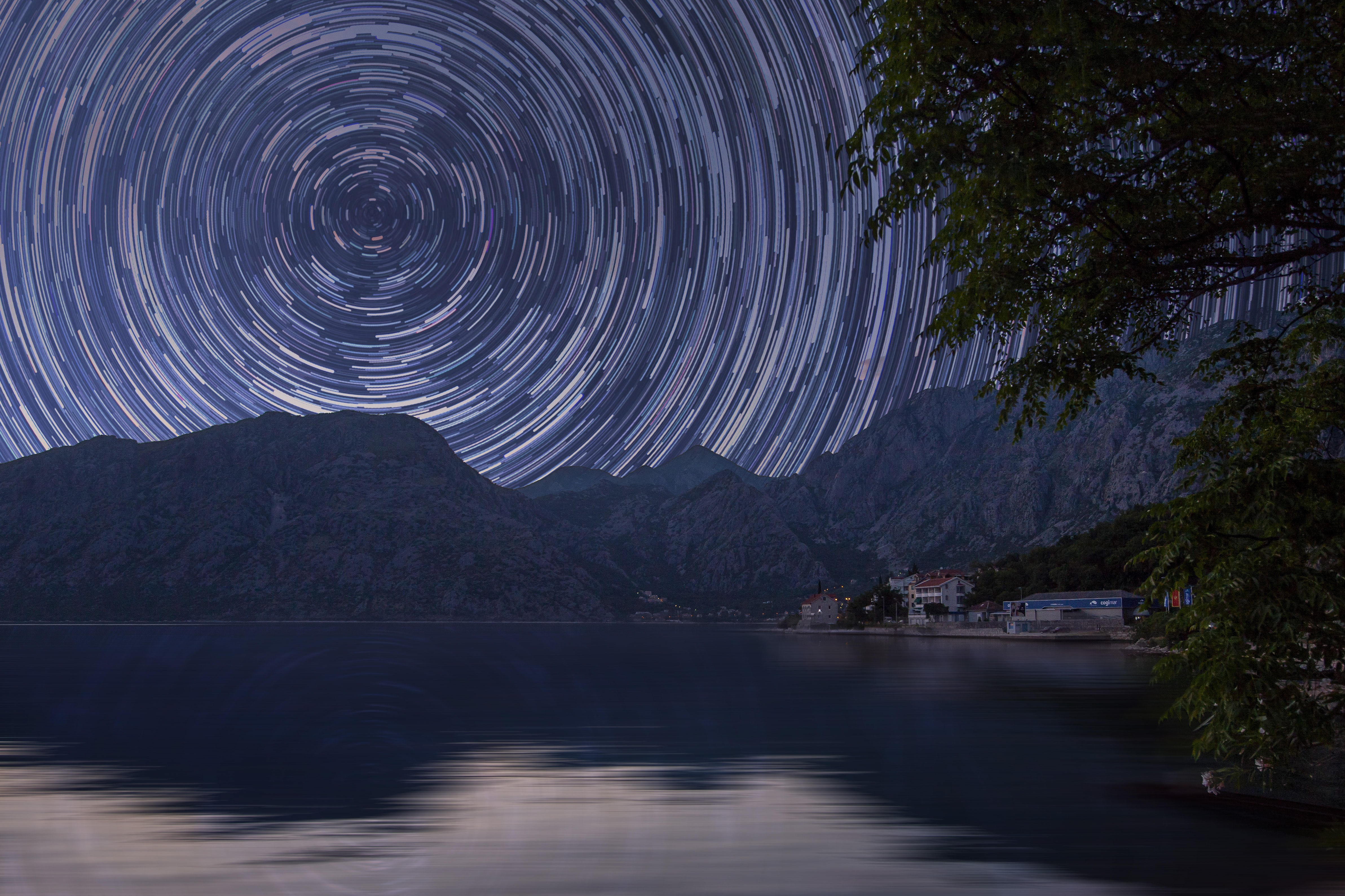 bodies of water near mountain at starry night