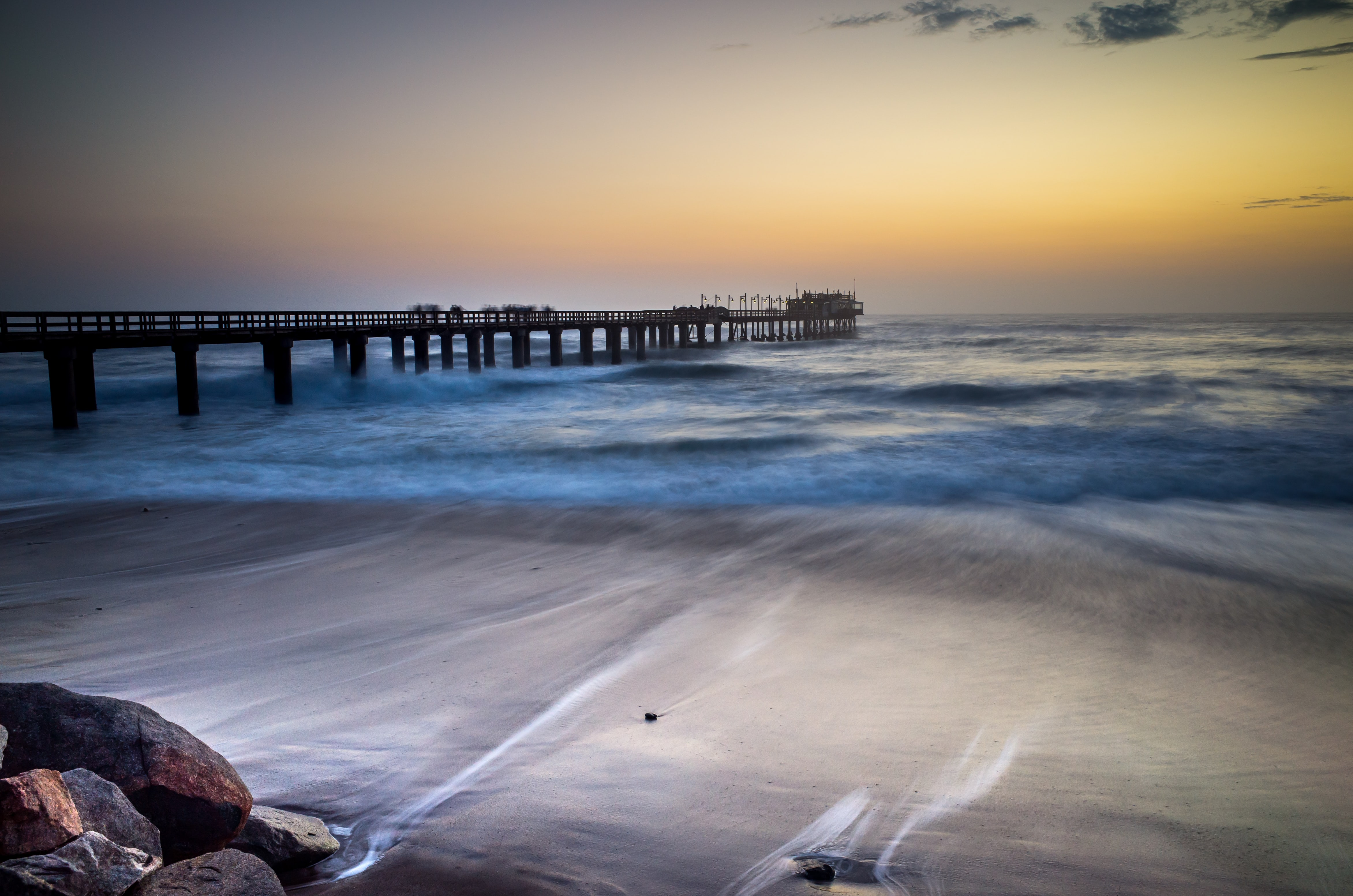 Dusk from the beach pier with low waves in Swakopmund, Namibie