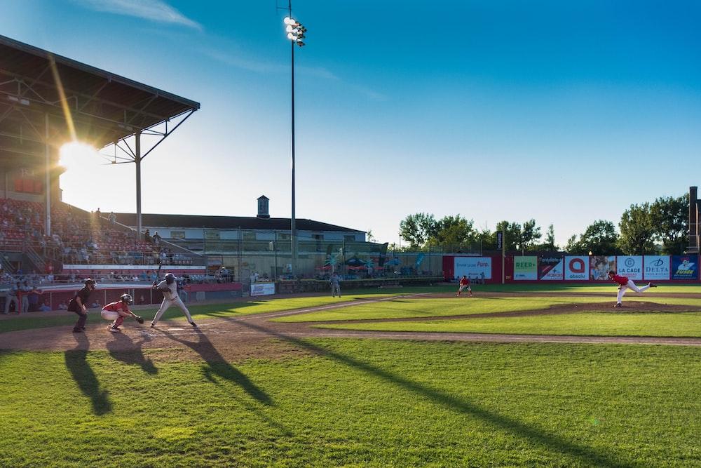 player playing baseball on ballpark