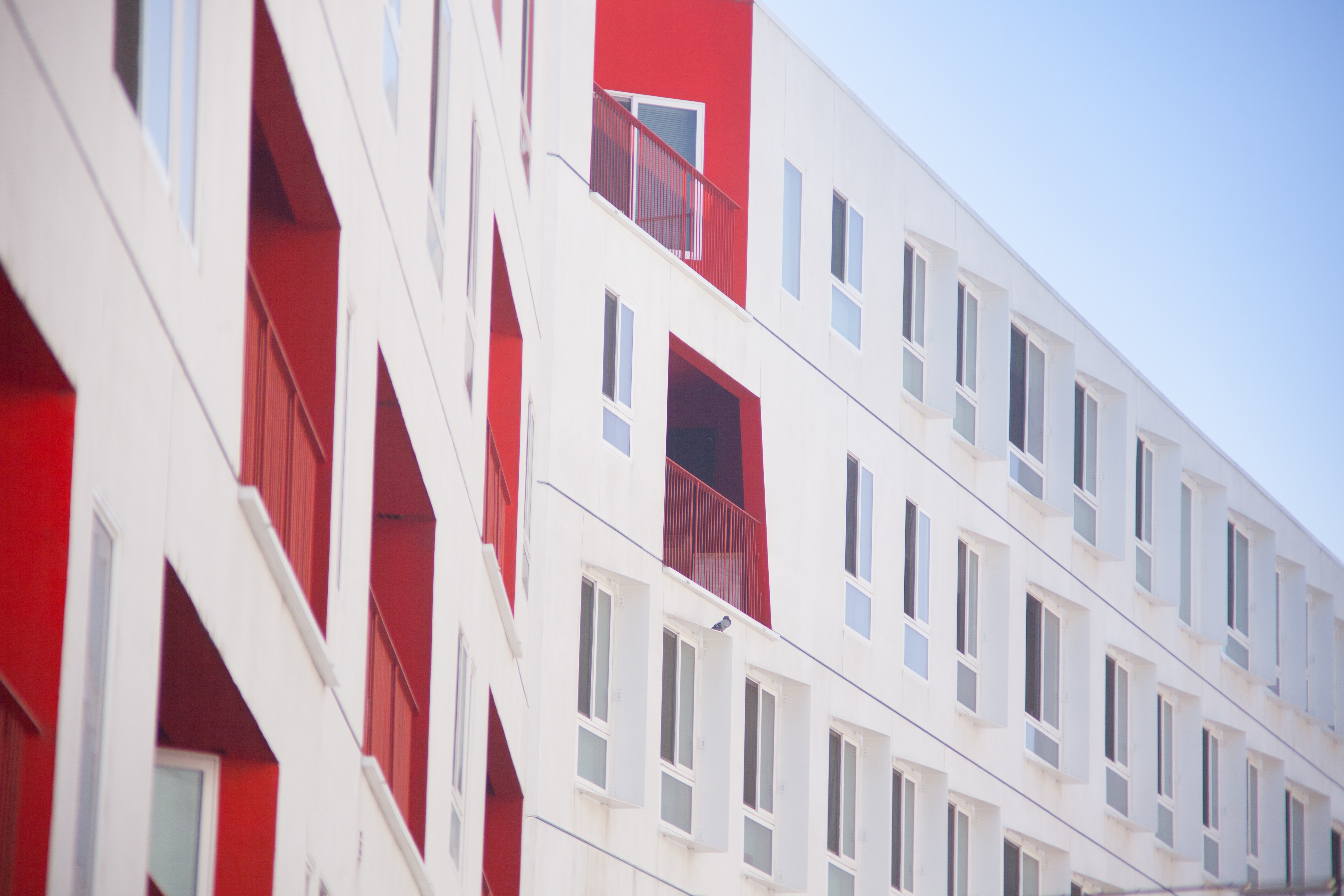 white and red concrete building atime