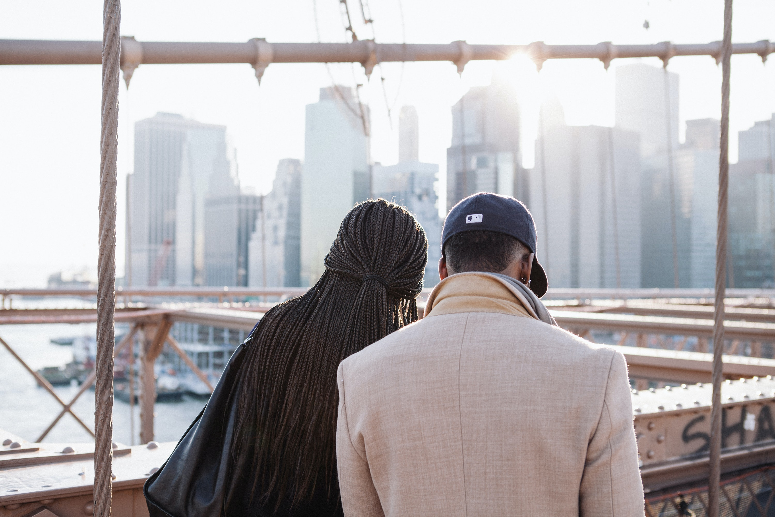 Two people looking down at a building site.