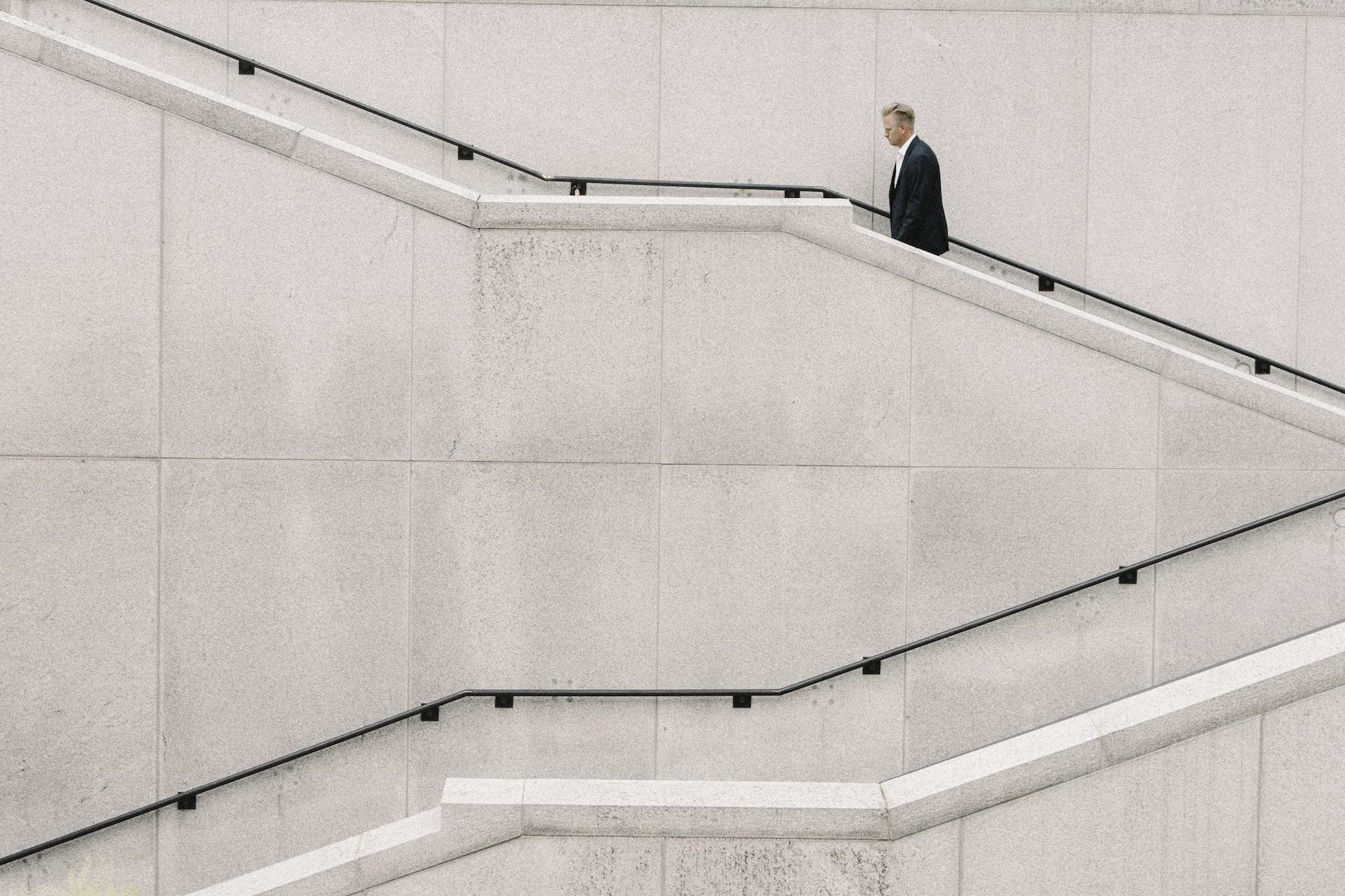 Man walking up concrete staircase