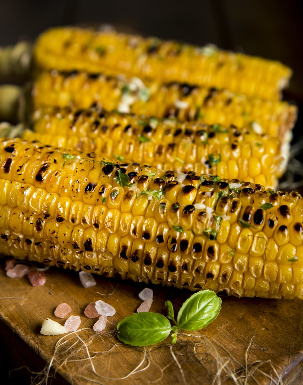 selective focus photography of grilled corns