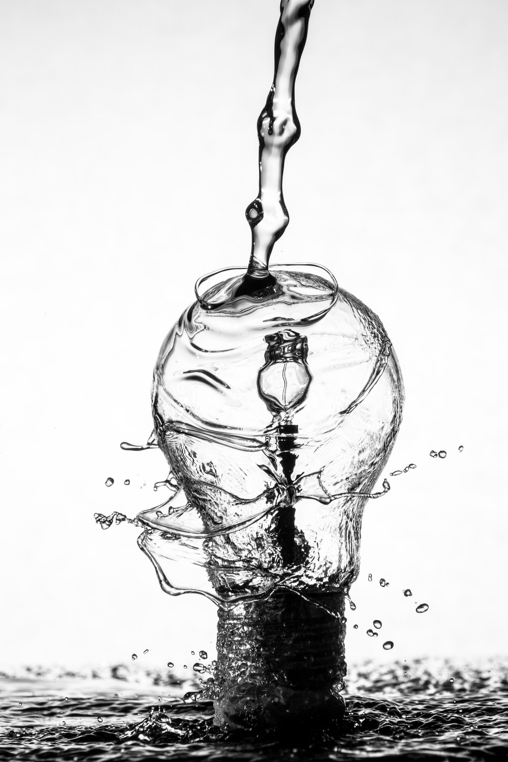 Water splashing against a lightbulb
