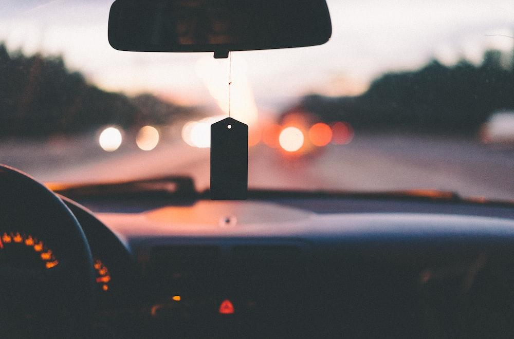 Dashboard, steering wheel, and air freshener in car on a highway in Moskovskaya Kovaltseva Avtomobilnaya Doroga