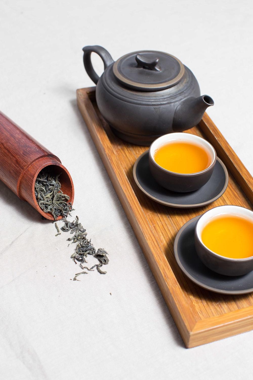 black ceramic teapot with cups
