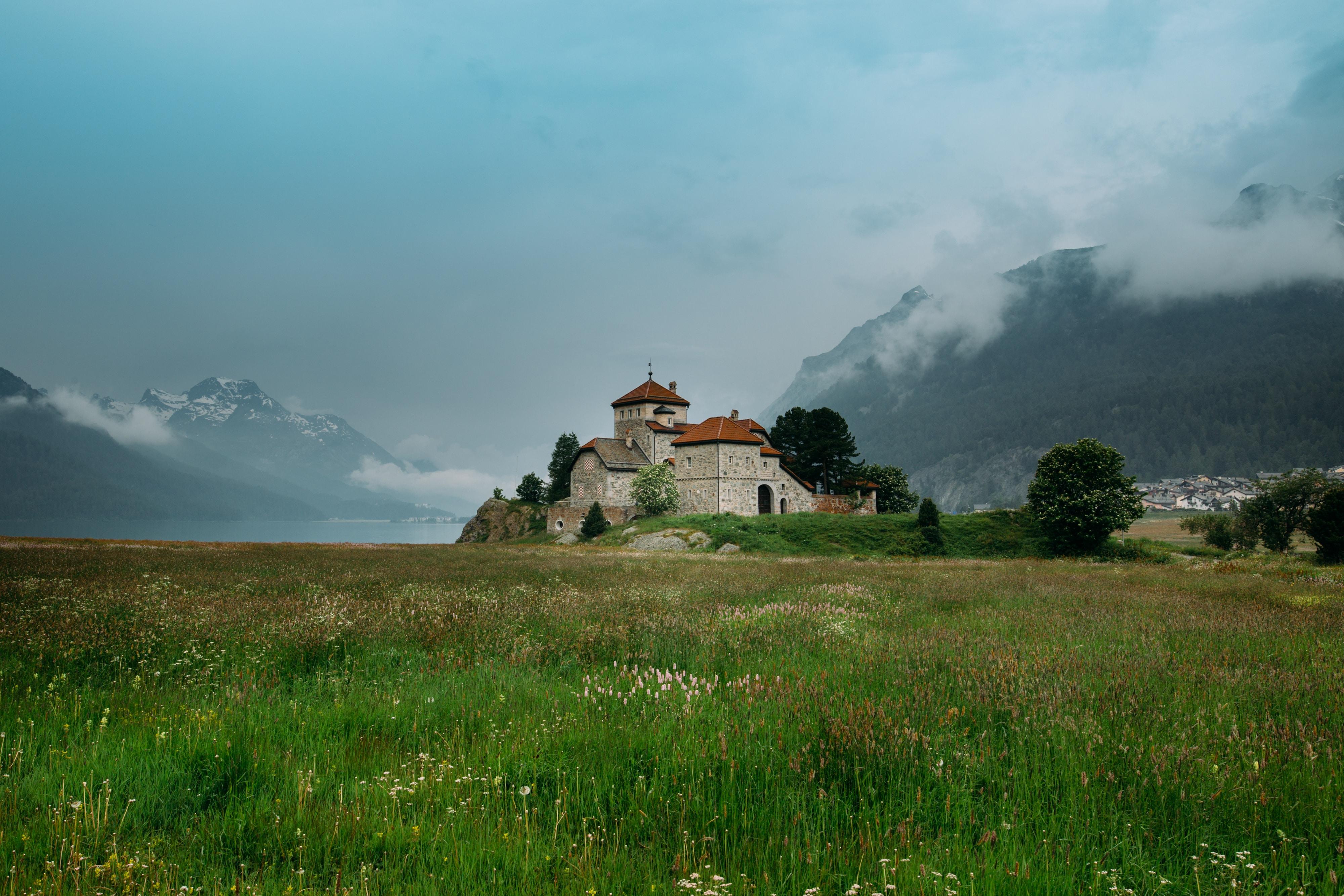 Historic castle in a grassy field in Saint Moritz