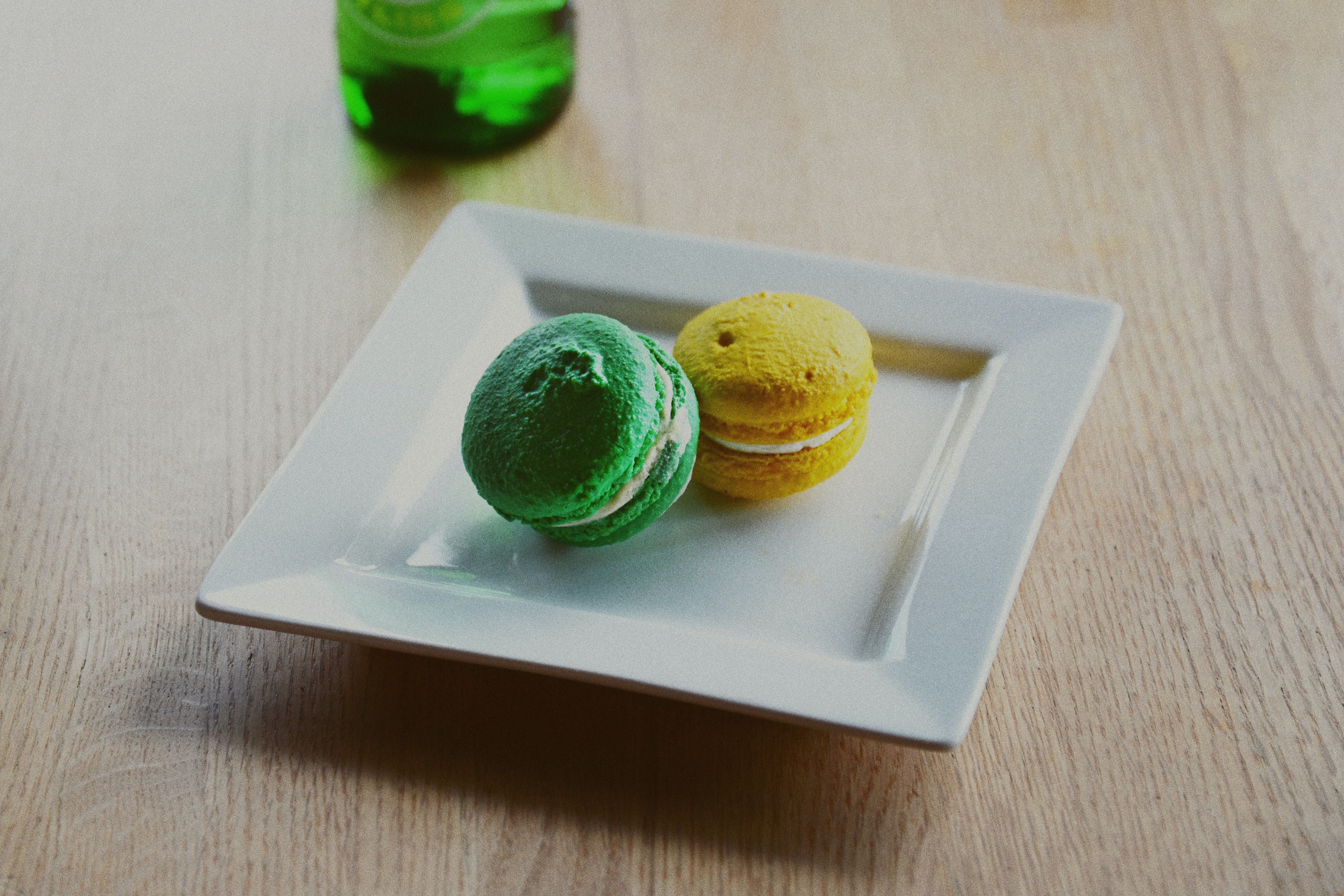 two macarons in square white plate
