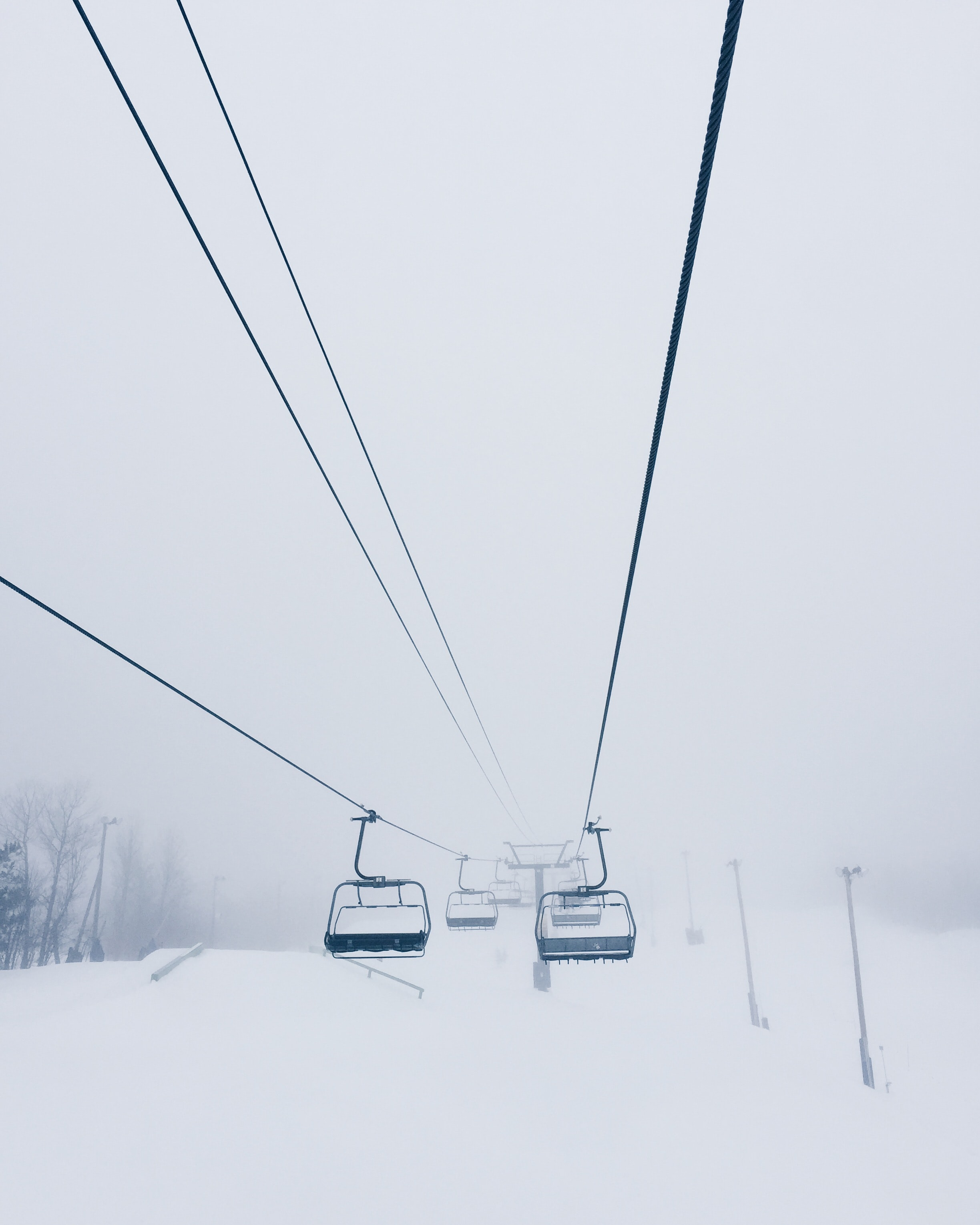 Foggy chairlift at Mont-Tremblant, Québec, Canada.