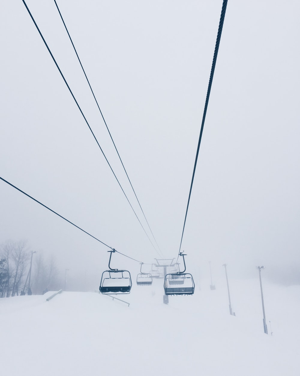 cable cart coated with snow
