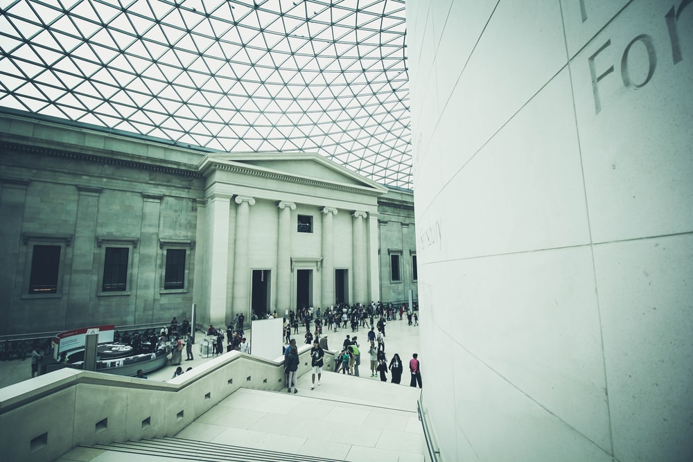 Crowds of tourists in the neoclassical interior of the British Museum