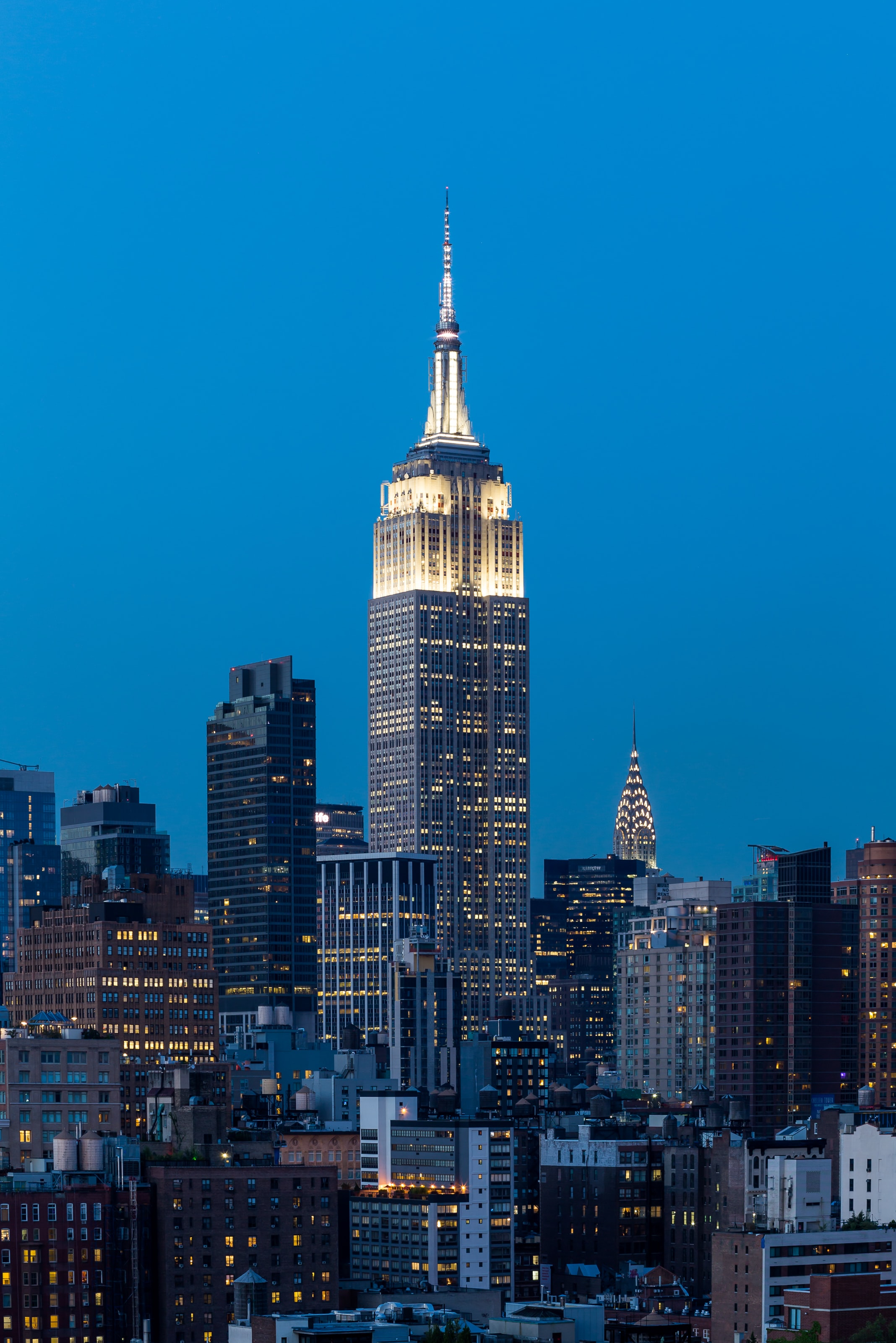 Empire State Building and skyscrapers with lights at night in New York City