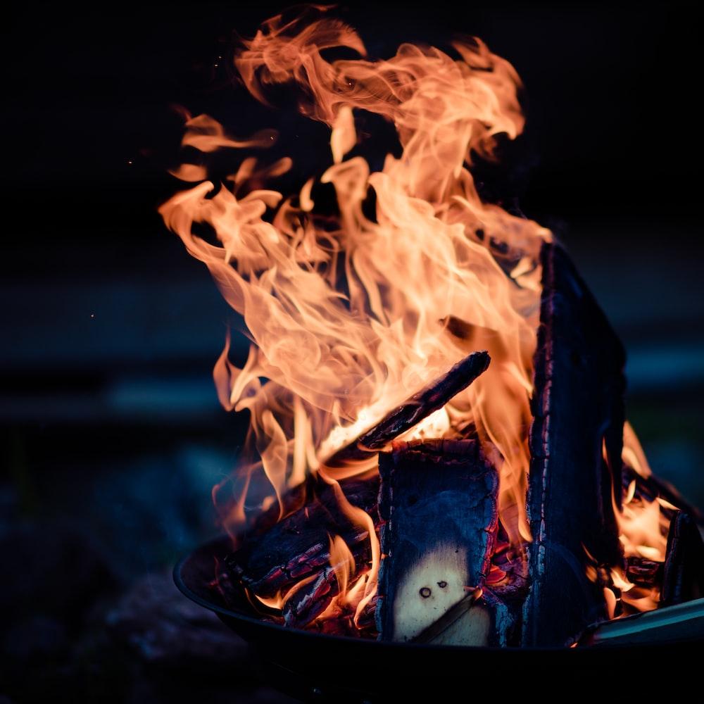 fire in black steel fire pit