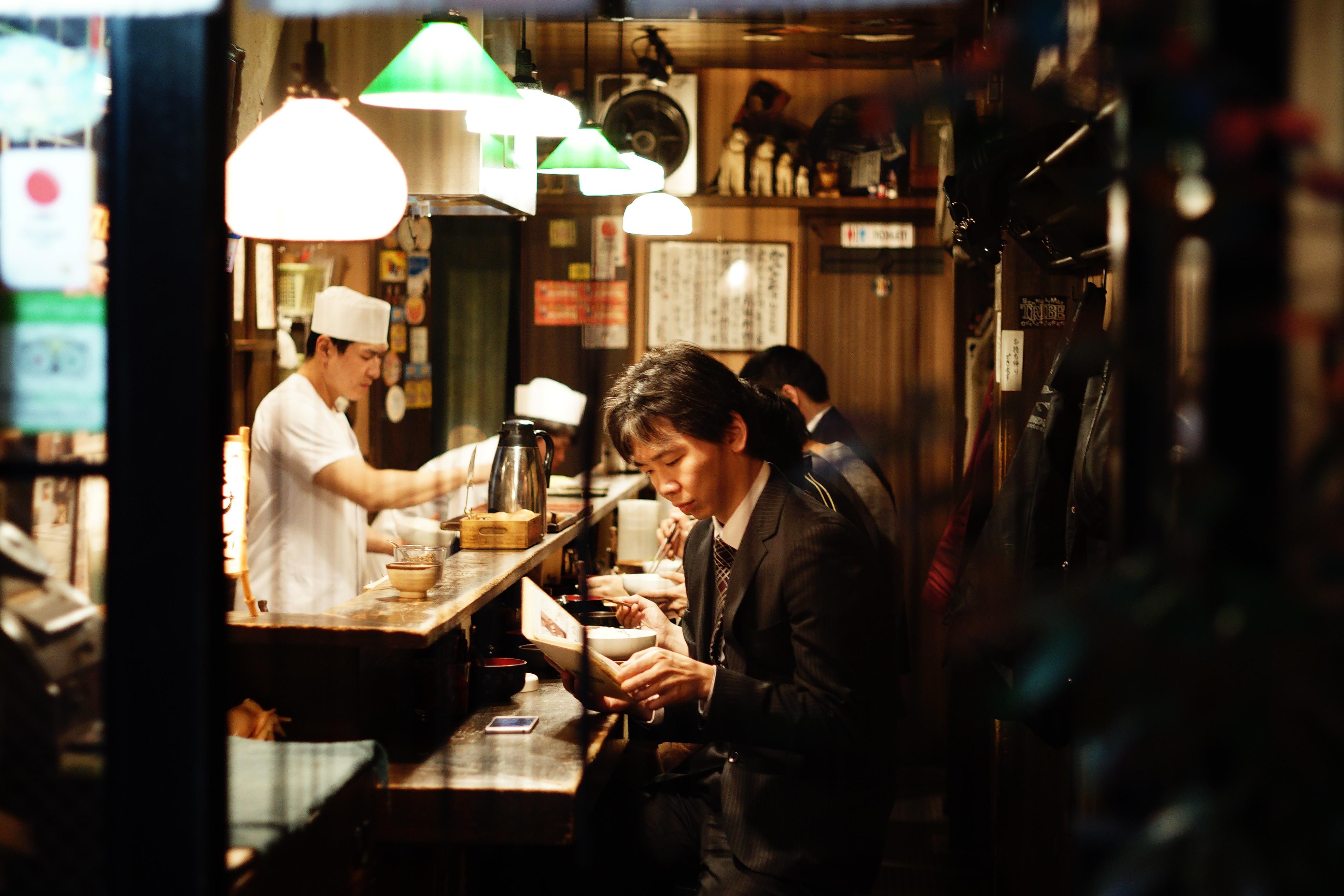 A man sitting at the counter at a Ramen restaurant in Shinjuku