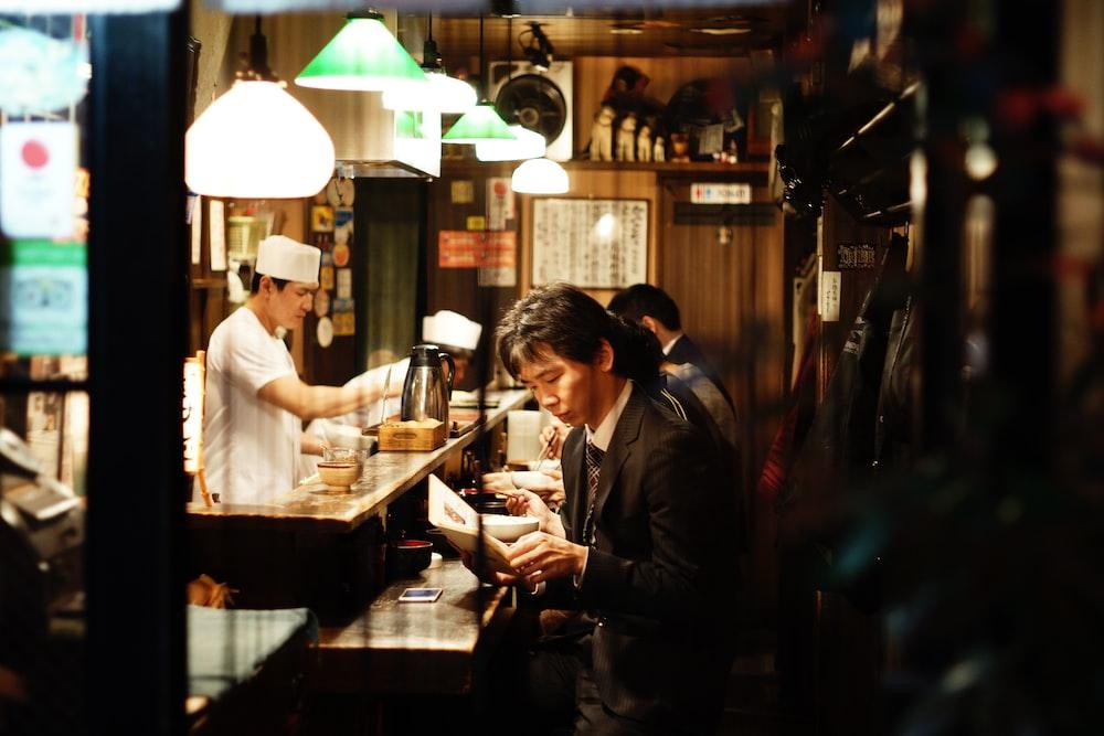 man holding menu