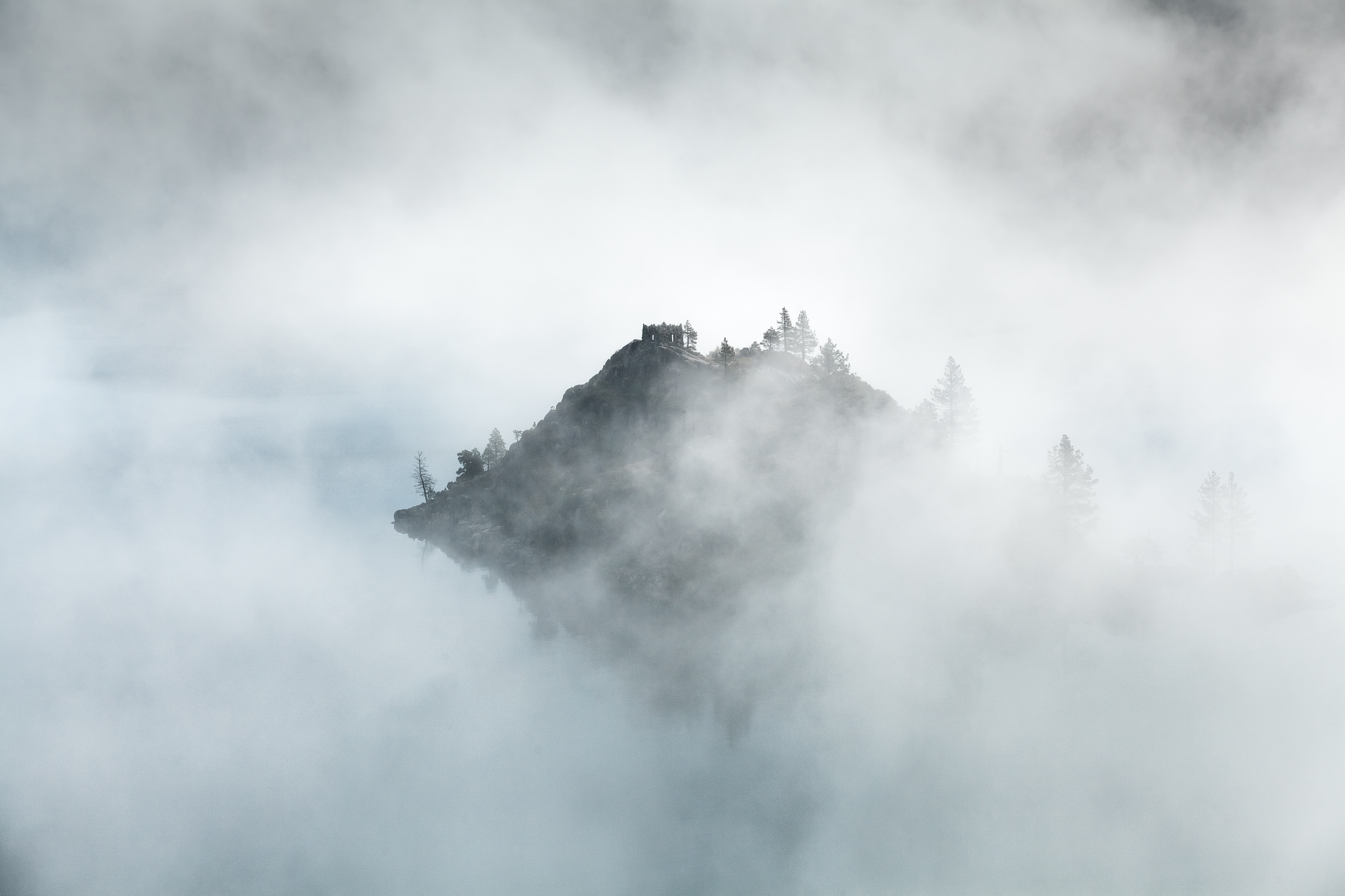 Mountain peak in Emerald Bay peeks through morning mist