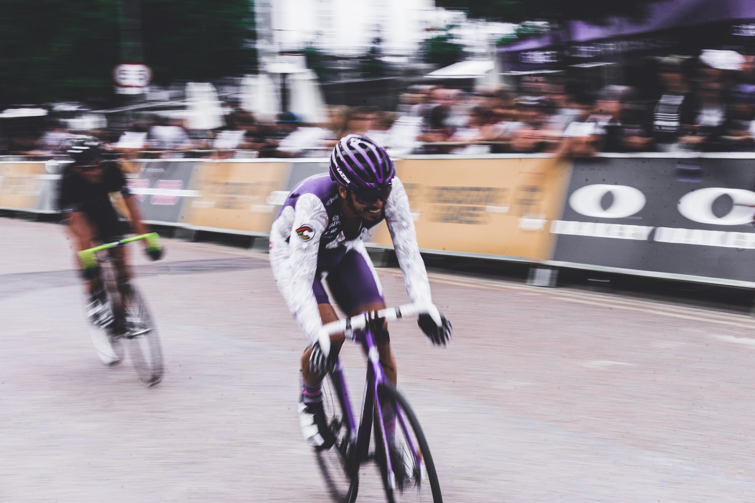 Two men cycling in a race in Greenwich
