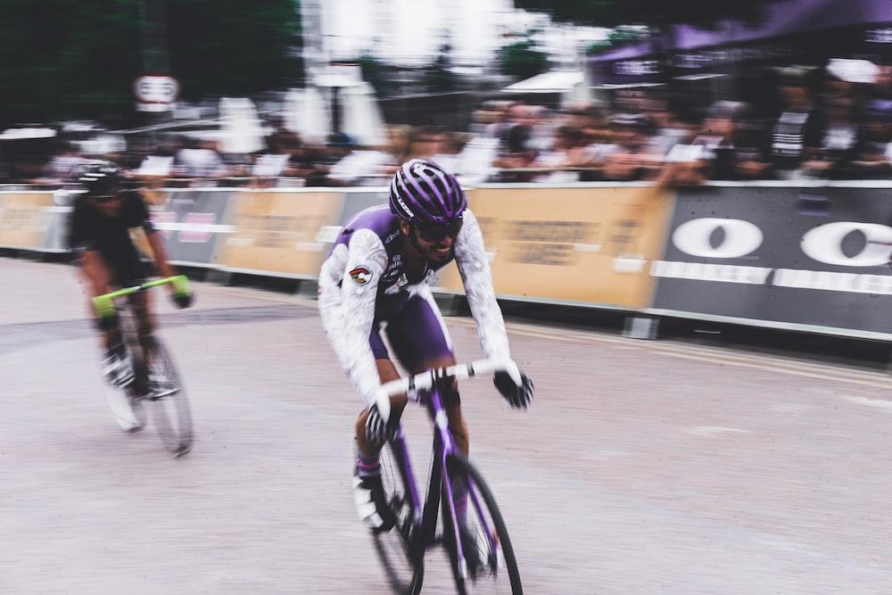 two men bike racing during daytime