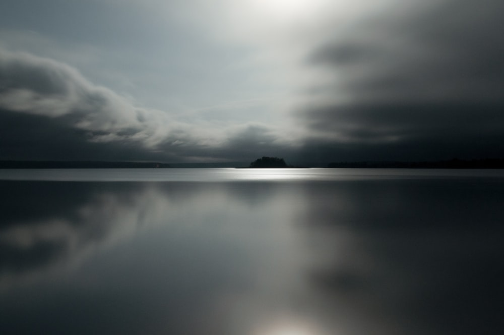 gray clouds reflected on water