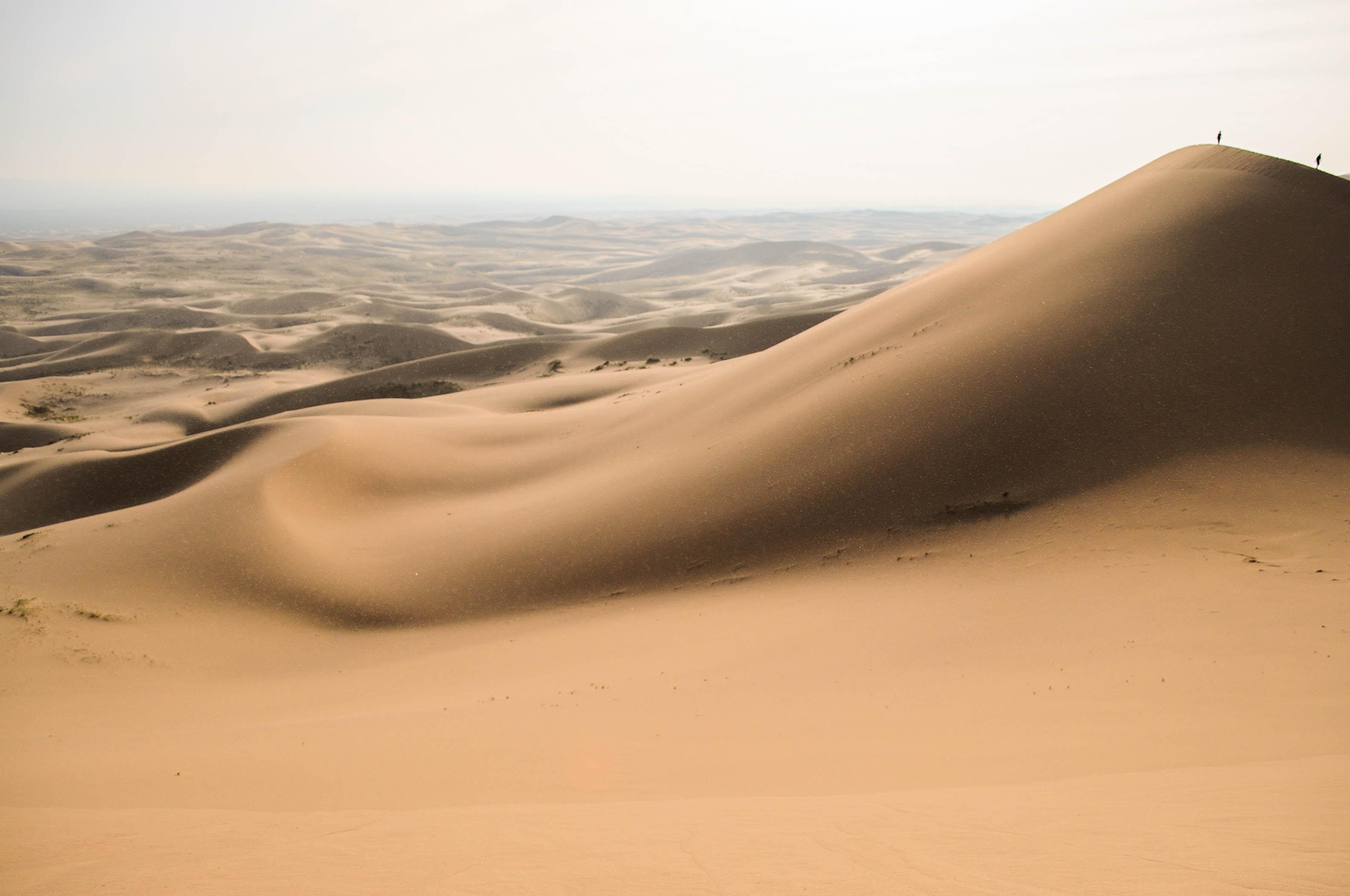 Walking on the sandy ridges of the desert in Khongoryn Els