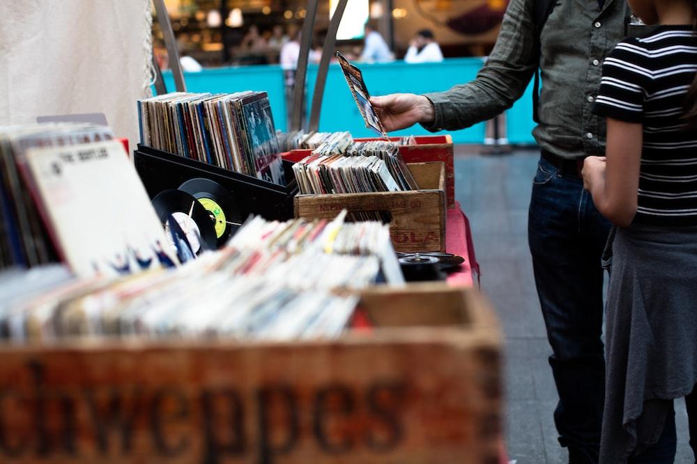 men standing in front of vinyl record sale