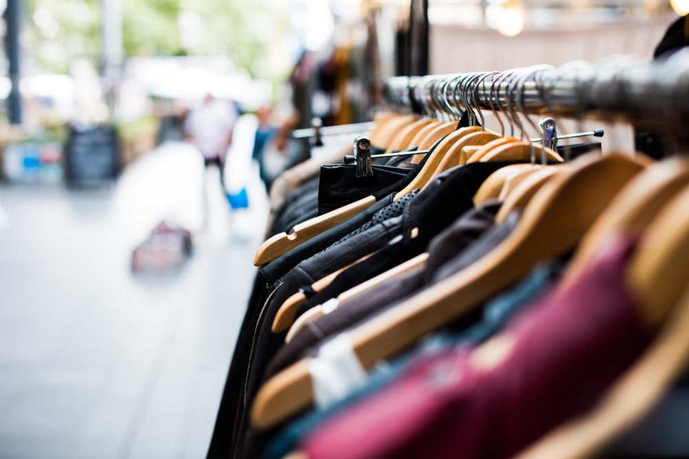 selective focus photography of hanged clothes