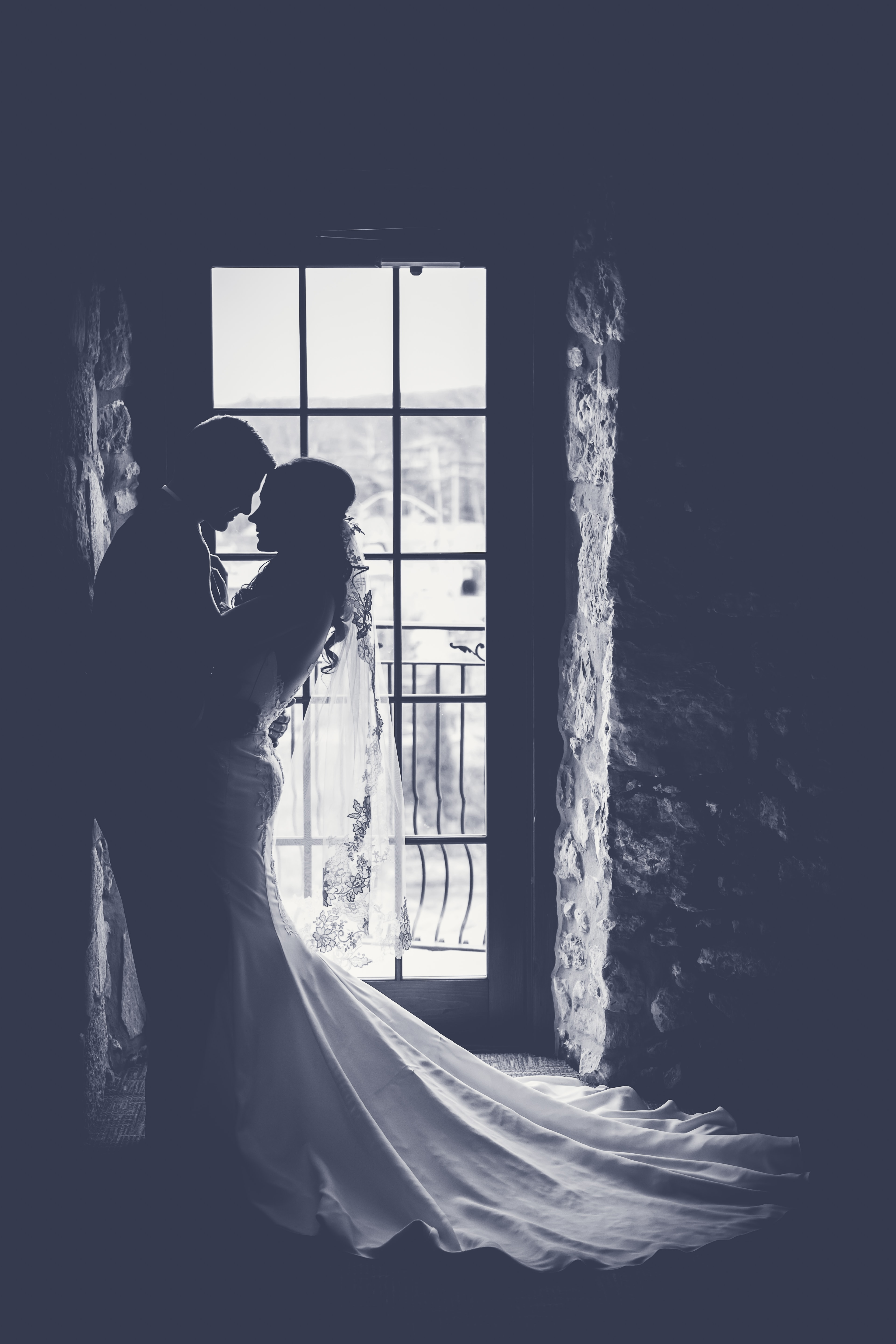 Sunlight streams through a doorway onto a just-married couple