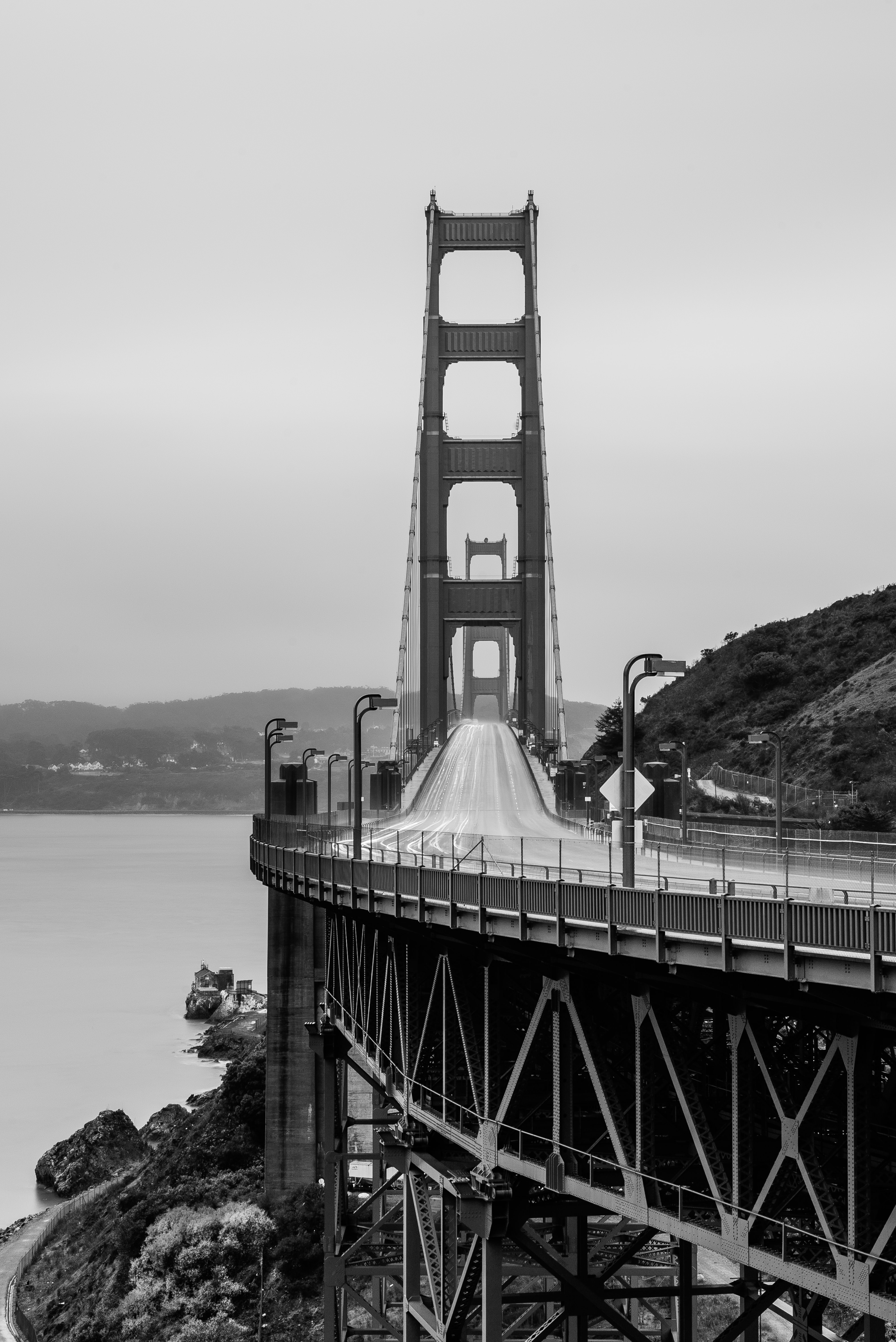 Black and white shot of Golden Gate Bridge Vista Point with empty road